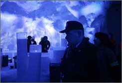 "Inside the Svalbard Global Seed Vault in Longyearbyen, Norway, a police officer looks on as last-minute ""doomsday"" preparations are made Tuesday."