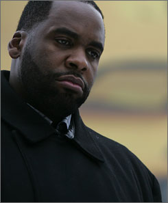 Detroit Mayor Kwame Kilpatrick looks on during the opening of Winter Blast events held at the Campus Martius Park in Detroit, earlier this month.