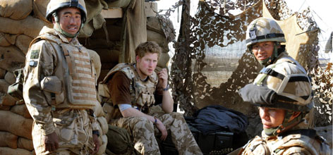 Britain's Prince Harry, second left, sits with a group of Gurkha soldiers after firing a machine gun from an observation post in Helmand province, Southern Afghanistan in January. The 23-year-old, an officer in the Household Cavalry regiment, has spent the past 10 weeks secretly serving in the volatile southern province.