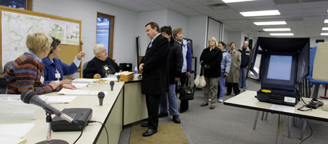 Voters line up to get a ballot for the Feb. 19,  presidential primary in North Lake, Wis. High voter turnout in primaries has spurred election officials to try to stem shortages before the November general election.