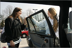 "Rosie Jermakian, 16, left, gets a ride after school from Kristin Phillips, 18, in Bethesda, Md. A new study outlines the most dangerous circumstances for young passengers riding with teen drivers. ""Teen drivers don't always think,"" says Jermakian, who has a learner's permit and hopes to get her license soon."