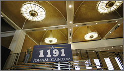 Workers prepare an election night party for John McCain in Dallas. The number 1191 is the amount of delegates McCain needed to clinch the Republican nomination.