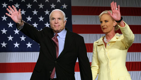 Republican presidential candidate John McCain and his wife Cindy wave to supporters in Dallas after he secured the GOP nomination Tuesday with a four-state sweep.