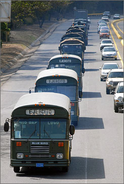 A military convoy moves in a highway in Valencia, some 100 km from Caracas, Venezuela, during deployment to the Colombian border.