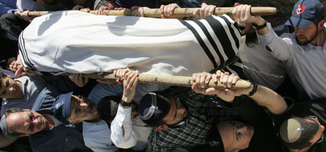Loved ones of 15-year-old student Segev Peniel Avihail carry his body at the Mount of Olives Jewish cemetery, on Friday. Avihail and seven other students were killed when a Palestinian gunman opened fire inside a seminary in Jerusalem yesterday.