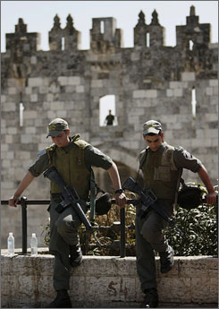 Israeli border police officers stand guard near the Damascus gate in the Old City of Jerusalem.