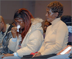 Cecil Dotson's mother and sister Nicole, left, and Pricilla Shaw attend a prayer service at First Baptist Church-Board, Tuesday.