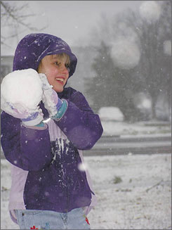 Eve Lavit brandishes her snowball creation, in Murray, Ky.