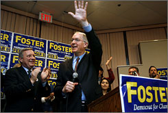 Newly elected Rep. Bill Foster, D-Ill., waves to supporters on Saturday in Aurora, Ill.