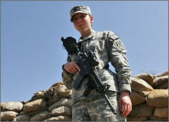 Spc. Monica Lin Brown of the Army's 82 Airborne Division stands guard at a forwarded operating base in Khost, Afghanistan on Saturday. Brown, from Lake Jackson, Texas, will be the second female soldier awarded the Silver Star since World War II.