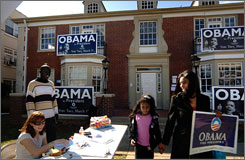 Pamela Grant and her daughter, Jailien Grant, 8, of North Jackson, Miss., leave the Barack Obama campaign headquarters on Sunday in Jackson, Miss.
