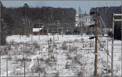 Transmission lines cut through the woods in Northumberland, N.H. State officials estimate that New Hampshire could contribute 1,064 megawatts of new renewable energy by 2025.