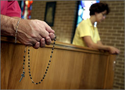 Parishioners at St. Mary's Catholic Church in Longview, Texas, pray the Rosary.