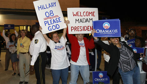 Clinton and Obama supporters wave campaign signs outside the 26th annual Jefferson-Jackson-Hamer Day Democratic party dinner Thursday in Canton, Mississippi.