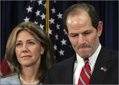 "New York Gov. Eliot Spitzer, standing alongside wife Silda, said in a news conference, ""I have acted in way that violates my obligations to my family."""