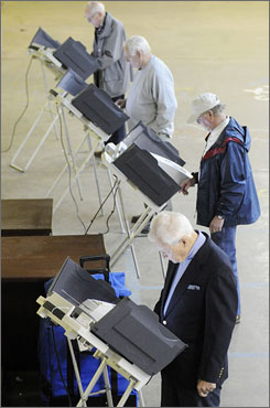 Voters cast their ballots in the primary election in Oxford, Miss., on Tuesday. The Democratic race continues to be a tight contest as Obama and Clinton seek the needed delegates to secure the nomination.