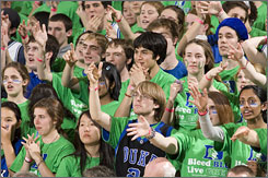 "As part of the Focus the Nation initiative, Duke University student fans in Durham, N.C., donned green  shirts emblazoned with the slogan ""Bleed Blue, Live Green"" for a basketball game in January."