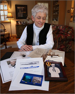 Mary Bentz looks over the memorabilia she's collected of the USS Grunion, a submarine that had been missing and presumed sunk since World War II.
