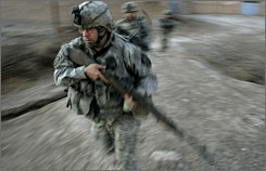 U.S. army soldiers from Blackfoot Company, 2nd Battalion, 23rd Infantry Regiment, run to take defensive positions during a firefight on the outskirts of Muqdadiyah, in the volatile Diyala province in Iraq. With the war reaching the five-year mark, most Americans say the invasion was wrong but have differing opinions on leaving.
