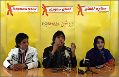 Lima Sahar, right, Hameed Sakhizada, center, and Rafay Nabzada, the three finalists in Afghan Star, Afghanistan's answer to American Idol, talk during a news conference in Kabul, Tuesday.