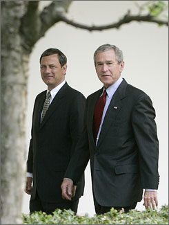 President Bush, right, and his then nominee for the Supreme Court, John Roberts, walk together after meeting at the White House in July 2005 in Washington.