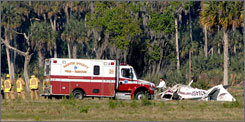 Fire and rescue personnel workat the scene of an airplane crash on Thursday near Indiantown, Fla.