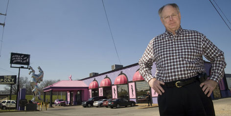 "Shelby County Commissioner Mike Ritz stands in front of a club, in Memphis, where a county ordinance bans alcohol in strip clubs and requires employee background checks and licenses. ""I don't think the law we adopted will get rid of them and we never said it would,"" he says."