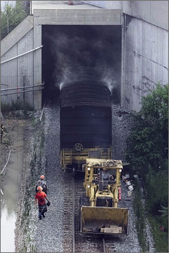 A rail car is towed July 19, 2001, from a tunnel in Baltimore after a CSX freight train carrying hazardous material derailed.