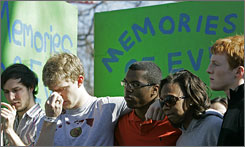 Students and friends gather during a memorial for University of North Carolina student body president Eve Carson in Chapel Hill, N.C., March 6. Carson was found dead on a street near the campus.