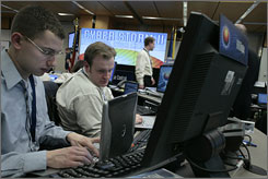 Dan Lidor, left, and Aaron Hixson participate in the Department of Homeland Security's largest cybersecurity exercise Thursday.
