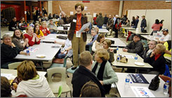 Precinct Chairwoman Judy Wittkop explains the rules during a caucus in Le Mars, Iowa, on Jan. 3. In the next phase of Iowa's delegate selection process, county conventions will choose delegates to the state's district and conventions this weekend.