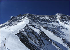 Climbers, left, tackle the North Ridge of Mount Everest in Nepal in May 2006. Nepalese officials say the summit will be closed to climbers during the first 10 days of May so the Chinese can carry an Olympic torch up the mountain.