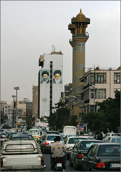 Murals of Iranian late revolutionary founder Ayatollah Khomeini, right, and supreme leader Ayatollah Ali Khamenei, are painted on the wall near the minarets of a mosque in central Tehran, Iran, on Saturday. Conservatives who strongly back Khamenei's rule made a strong showing in partial results from Iran's parliament elections.