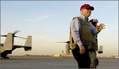 Sen. John McCain arrives at Baghdad's International Airport on Sunday.