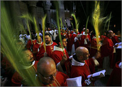 Roman Catholic clergymen carry palm fronds during the Palm Sunday procession in the Church of the Holy Sepulcher, traditionally believed by many to be the site of the crucifixion, in Jerusalem's Old City.