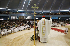 The first mass is held at St Mary's Roman Catholic church in Doha, Qatar.