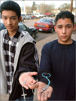Marco Castro,16, left, and Jaime Salazar, 14, show the rosaries that led to their suspension from South Albany High School in Albany, Ore., Feb. 23.
