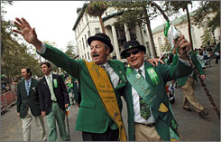Fourth-generation Savannah residents and cousins Danny and Ted Robertson, right, wave to friends while walking in the St. Patrick's Day parade.