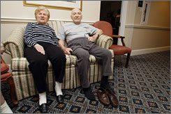 Jeannette Zeltzer, 81, and boyfriend Max Rakov, 92, sit at an assisted living facility where they live in Newton, Mass. Zeltzer recently lost her husband and now spends time holding hands with Rakov, who also suffers from Alzheimer's.