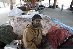 Alex Clay sits on his mattress at a homeless camp under the I-10 overpass at Claiborne Avenue and Canal Street in New Orleans, La., after losing his Lower 9th Ward in Hurricane Katrina's fury.