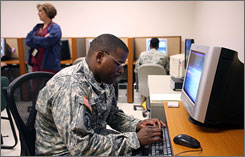 Army Sgt Marcus Brown fills out a TBI Survey at the Soldier Readiness Center at Ft. Carson, Colo., on Feb. 26. Brown has been deployed twice to Iraq.