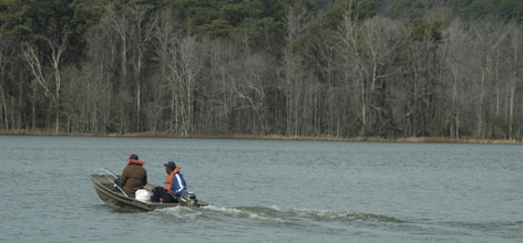 Henry Jones, left, and Tracy Herron, right, of Birmingham, Al., head out for a day of fishing on a nearly full Lake Purdy.