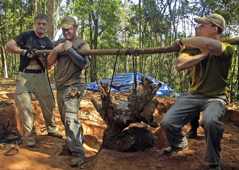 Members of the Joint POW/MIA Accounting Command and local villagers work together escavating a crash site in Dong Hoi, Vietnam, last July. JPAC's mission is to achieve the fullest possible accounting of all Americans missing as a result of the nations past conflicts.
