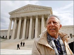 Dick Anthony Heller outside of the Supreme Court building in Washington on Tuesday. Heller sued the District of Columbia after it rejected his application to keep a handgun at home for protection.