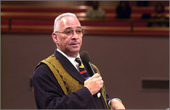 Rev. Jeremiah Wright of Trinity United Church of Christ in Chicago offers words of comfort to mourners at a funeral service in this Dec. 23, 2000, file photo. In a speech on race on Tuesday, Democratic presidential hopeful Barack Obama, a member of wright's church, denounced comments by the pastor that have been labeled divisive.