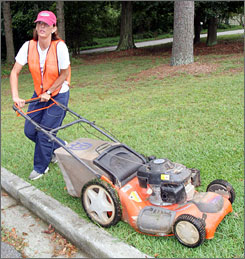 Runaway bride Jennifer Wilbanks mows the lawn of a government building, in Lawrenceville, Ga., in 2005, as part of her sentence for lying to police after she ran off days before her scheduled wedding to John Mason.