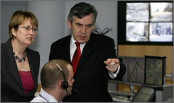 The day before Britain's Prime Minister Gordon Brown gave his speech on national security, he and Home Secretary Jacqui Smith, top left, visited the Metropolitan Police's Central Communications Command in London. Brown said he plans to establish regional intelligence units to help local police in anti-terrorism activities.