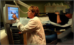 Talli Hewlett, a radiation therapist at the Arizona Cancer Institute, sets up the Calypso 4D Localization System to pinpoint radiation for prostate cancer patient Ray Sims, Dec. 11.