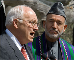 "Standing beside Afghan President Hamid Karzai at a news conference Thursday, U.S. Vice President Dick Cheney told the people of Afghanistan that they have ""made a bold, confident journey throwing off the burden of tyranny and winning your freedom,"" but cautioned that the the threat of al-Qaeda still loomed."