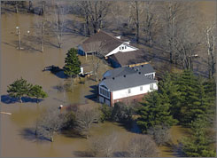 A home of Poplar Bluff, Mo. is surrounded by flood waters from the Black River March 20. Authorities are straining to keep pace with some of the worst flooding to hit their region in decades.